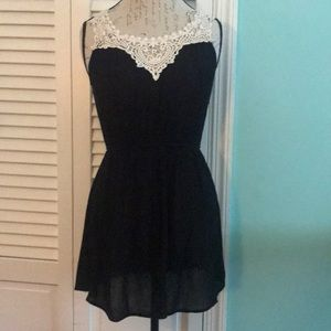 LBD with cream lace detail at neck